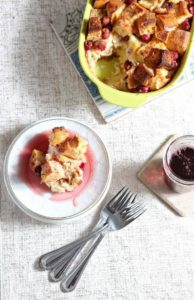 Overhead image of a serving of Cranberry Overnight French Toast on a glittery tablecloth