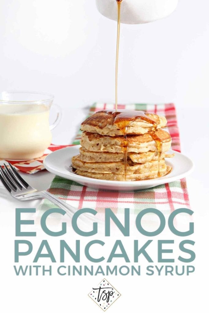 Cinnamon Maple Syrup pours on top of a stack of pancakes with the text 'eggnog pancakes with cinnamon syrup'