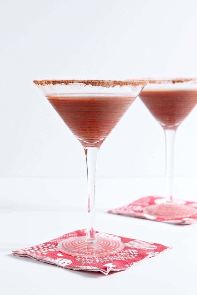 Celebrate your Valentine (or Galentine) in style with a homemade Vanilla Hot Chocolate Martini. Sweet, chilled and utterly delicious, this dairy-free twist on a classic martini goes down smooth and makes a perfect dessert cocktail!