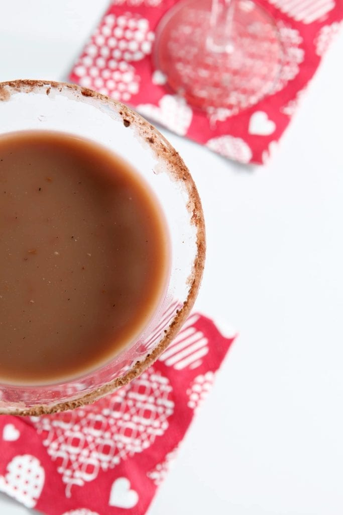 Celebrate Valentine's or Galentine's Day in style with a homemade Vanilla Hot Chocolate Martini. Sweet, chilled and utterly delicious, this dairy-free twist on a classic martini goes down smooth and makes a perfect dessert cocktail!