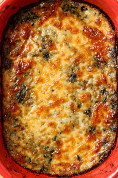 Spinach Madeline is a comforting side that is a spicy twist on traditional creamed spinach. Instead of just cream, the spinach is mixed with pepperjack cheese and spices, then baked to make this outstanding vegetarian side dish that pairs well with most meals!