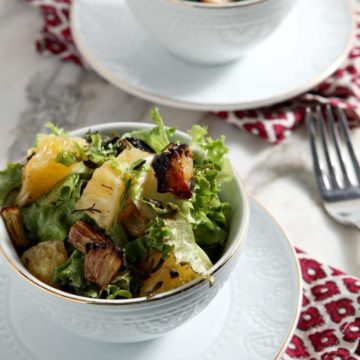 Roasted Fennel Orange Salad presents the perfect way to eat vegetables and fruits during the wintertime! Fennel is roasted, then tossed with fresh lettuce, peeled oranges and a honey vinaigrette to create a slightly sweet, delicious appetizer or side salad.
