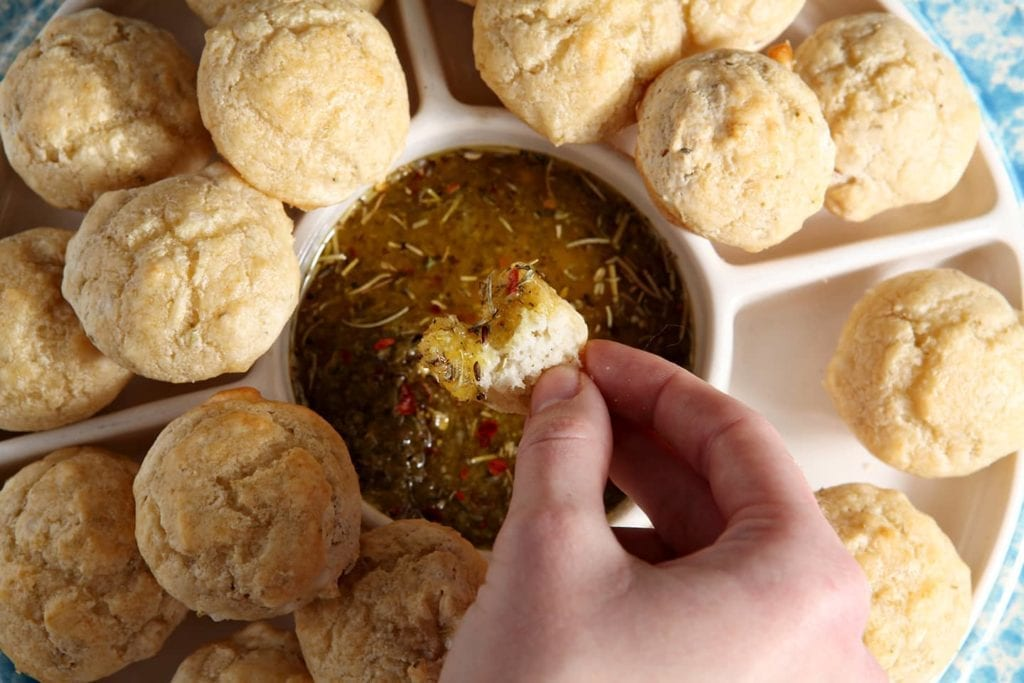 Olive Oil Parmesan Spice Dipping Sauce is an easy-to-make dip that tastes delicious with any savory bread. This dipping sauce works with bread at the beginning of a meal or paired with an appetizer, like Boardwalk Food Company's Rosemary Sea Salt Pretzel Poppers.