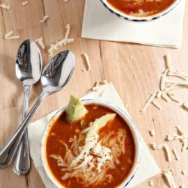 Turkey Taco Soup is a simple, delicious wintertime meal. Easy to make and even easier to eat, this soup adds a zing of spice and lots of vegetables to liven up any weeknight meal. Ground turkey is sautéed with onion and garlic, then peeled tomatoes, refried beans, diced chiles, corn and chicken stock are added before the soup simmers for 30 minutes. Finish with cheese, avocado or a dollop of sour cream to highlight this well-spiced soup.
