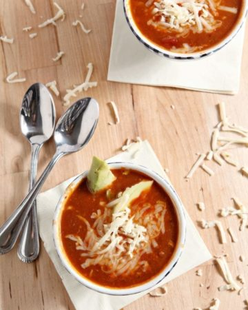 turkey taco soup in white bowls with two spoons