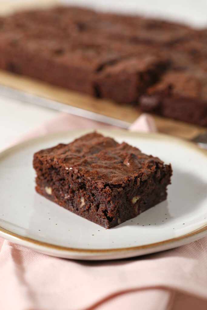 A bourbon pecan brownie on a plate