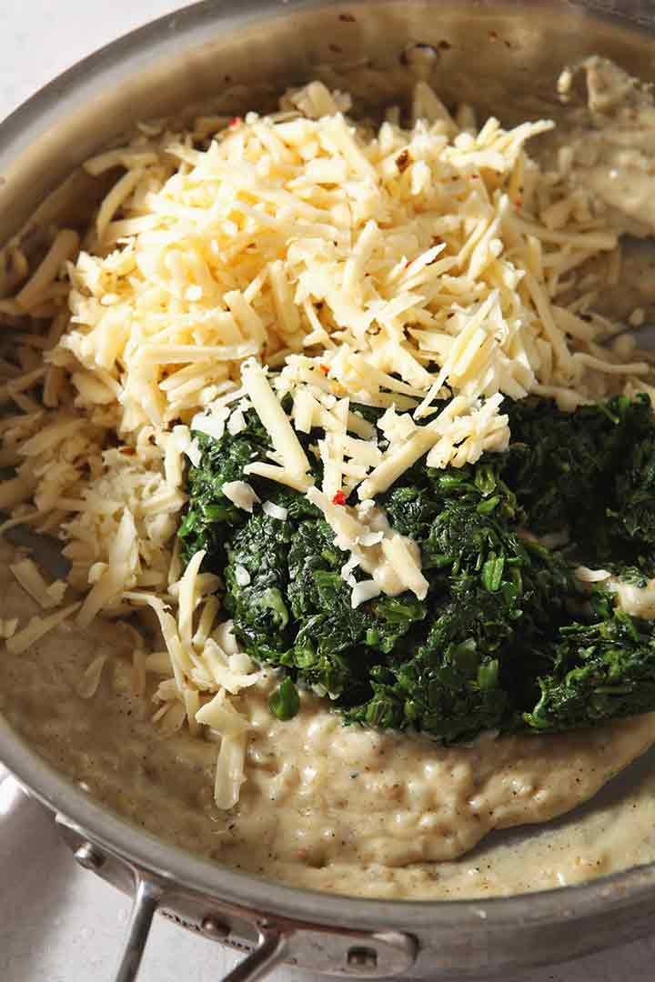 Steamed spinach and pepperjack cheese are added to the sauce to make the creamed spinach dish