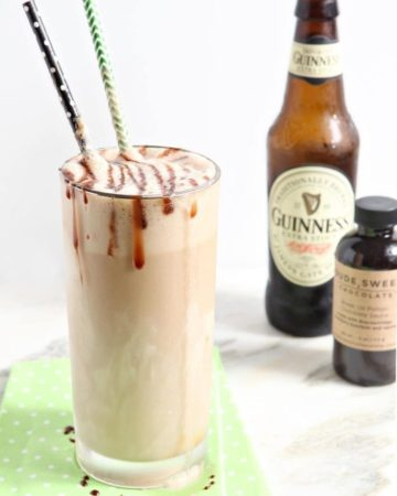 salted caramel guinness float in a glass with a bottle behind