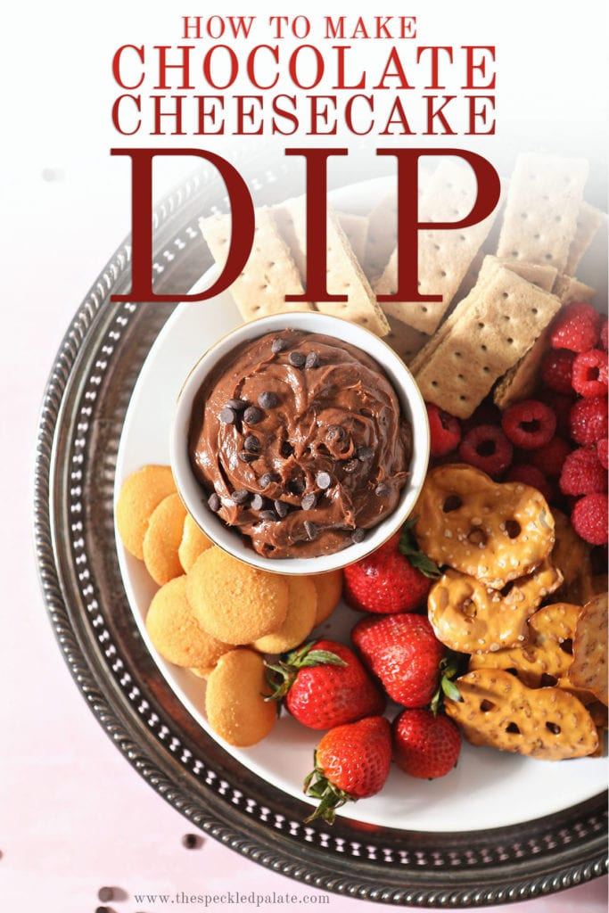 A platter holding chocolate fruit dip surrounded by crackers, fruit and cookies with the text 'how to make chocolate cheesecake dip'