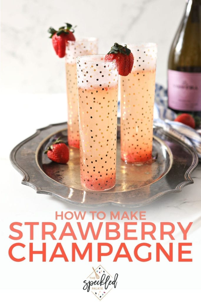 Three flutes holding a pink bubbly drink sit on a silver platter, garnished with fresh strawberries with the text 'how to make strawberry champagne'
