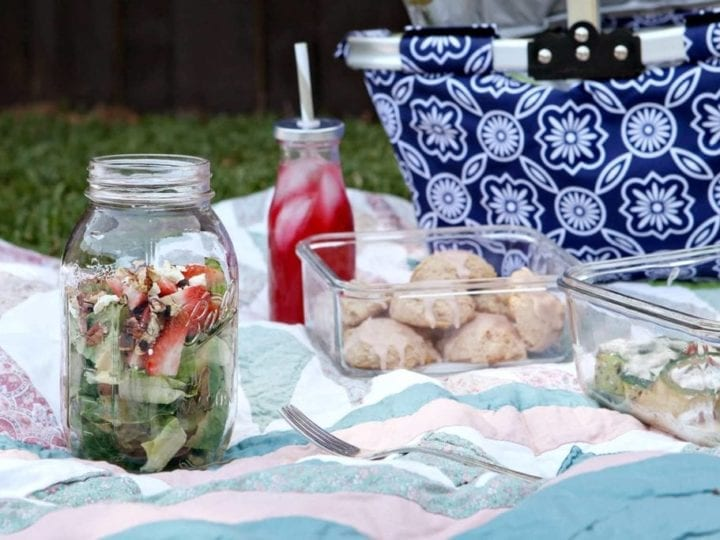 Planning to picnic this spring and summer? Bring Strawberry Romaine Salad in a Jar along as a tasty, seasonal side dish. Romaine lettuce is layered into a mason jar, followed by fresh, sliced strawberries. The lettuce and fruit are topped with toasted pecans and feta cheese, then tossed in a homemade lemon vinaigrette to complete the dish. These salads in a jar travel well, store well, and are easy to enjoy at any warm-weather outdoor event you might be attending!