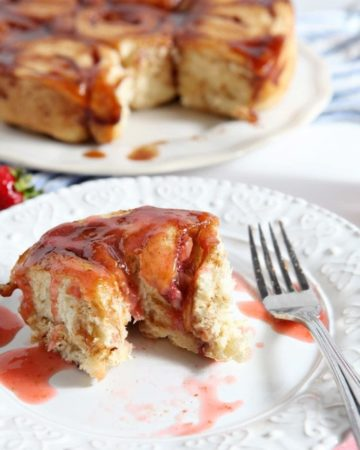 Strawberry Cinnamon Breakfast Buns are the perfect baked good for Mother's Day! This dairy-free adaptation of a classic cinnamon roll takes on seasonal flavors with the addition of fresh strawberries. This treat is drizzled with a strawberry glaze as a final touch. Serve these buns up with a mimosa, and brunch is served!