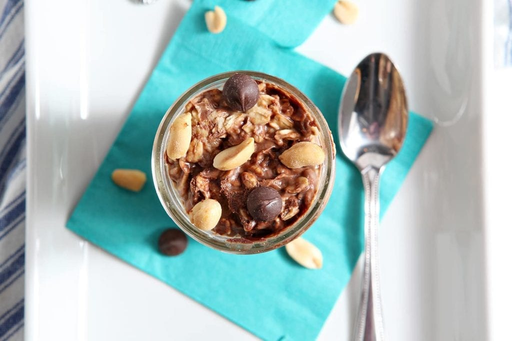 Vegan Peanut Butter Chocolate Chip Overnight Oats make a perfect high protein breakfast for runners and non-runners alike! Peanut butter, cashew milk, rolled oats, a little bit of maple syrup and dark chocolate chips marinate overnight in the refrigerator. This naturally sweetened, easy to make breakfast never looked so good!