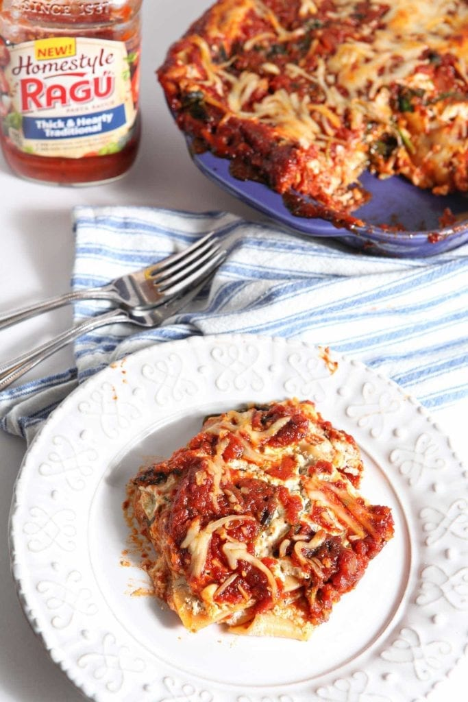 Vegetarian Spinach Lasagna, made with RAGÚ® Homestyle Sauce, is a simple, delicious and balanced homestyle meal! RAGÚ® Homestyle Thick & Hearty Traditional Sauce serves as the base of this lasagna, which is layered with no-boil noodles, a cottage cheese-ricotta mixture, sautéed spinach and mozzarella. Once the lasagna is put together, it bakes to perfection. This Vegetarian Spinach Lasagna is comfort food that is perfect for the entire family. #ad #SimmeredinTradition #HomestyleSauces