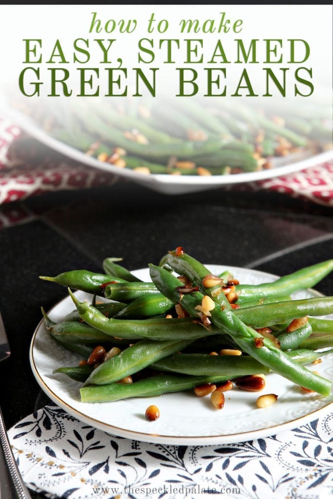 A white plate holds a serving of Vegan Green Beans with Toasted Pine Nuts and shallots with the text 'how to make easy, steamed green beans'