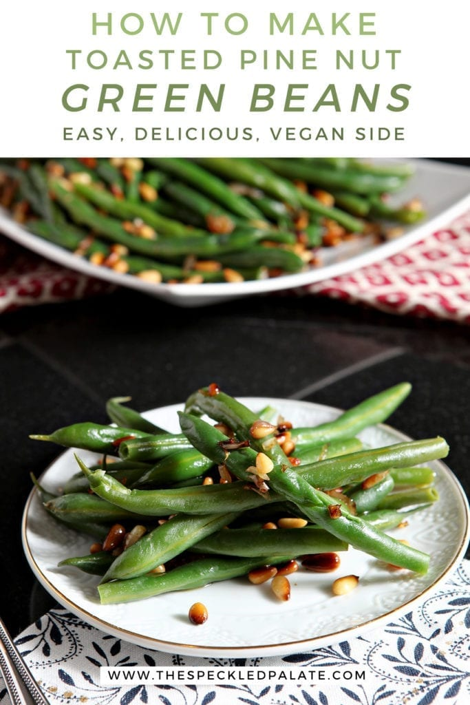 A white plate holds a serving of Vegan Green Beans with Toasted Pine Nuts and shallots with the text 'how to make toasted pine nut green beans. easy, delicious, vegan side'