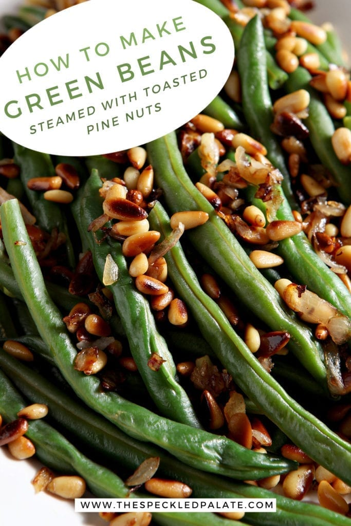 Close up of a platter holding Vegan Green Beans garnished with Toasted Pine Nuts and shallots with the text 'how to make green beans. steamed with toasted pine nuts.'