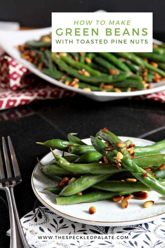 A white plate holds a serving of Vegan Green Beans with Toasted Pine Nuts and shallots with the text 'how to make green beans with toasted pine nuts'