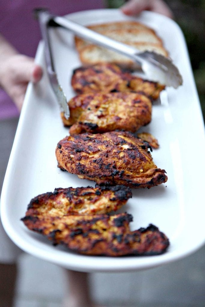Fire up the grill this summer and make Grilled Chicken Shawarma for the family! This Middle Eastern dish - which can be made with chicken, lamb, beef and more - is traditionally cooked on a vertical spit. This rendition, which is just as flavorful, spicy and delicious, can be made on the grill at home! The meat is marinated, then grilled. Served with fresh pita, Tzatziki sauce, salad, Grilled Chicken Shawarma is the perfect entree for any cookout!