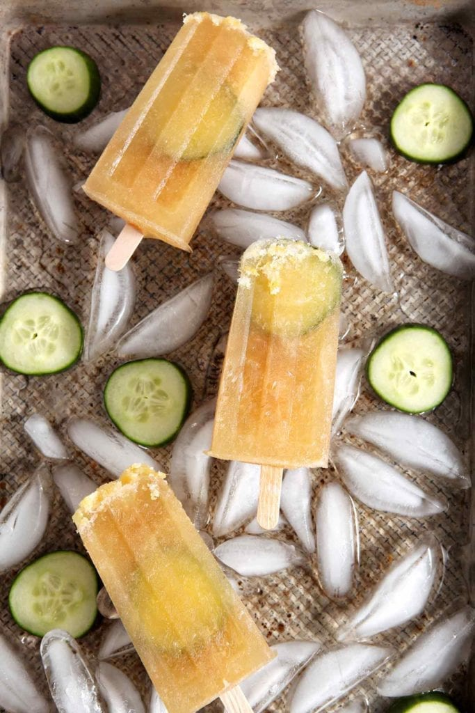 Pimm's Cups are refreshing summertime cocktails that go down easy on hot days. Why not take a classic Pimm's Cup... and transform it into a popsicle? Pimm's No. 1, ginger ale, lemon juice and agave nectar are blended together to create the base of these popsicles. The mixture is then poured into popsicle molds! Add a slice of cucumber once the pops begin firming up, and voila! You've got the perfect boozy popsicles for summer AND #popsicleweek!
