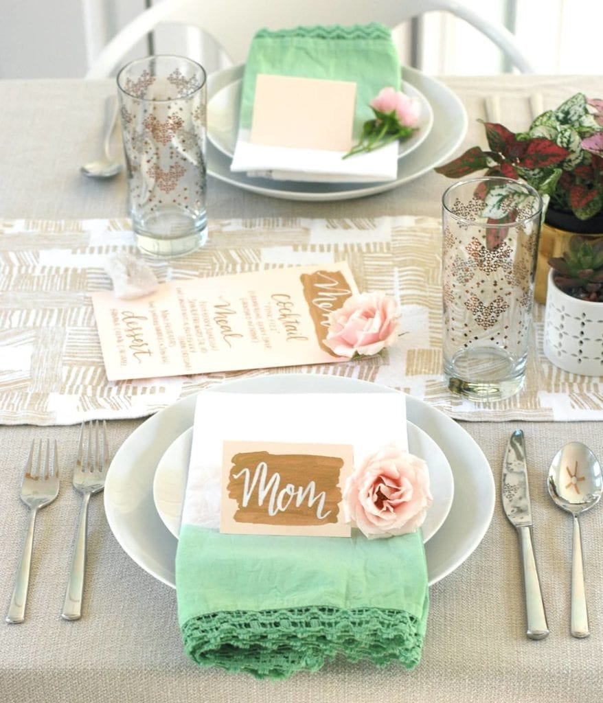 Decorated table with two places settings and flowers