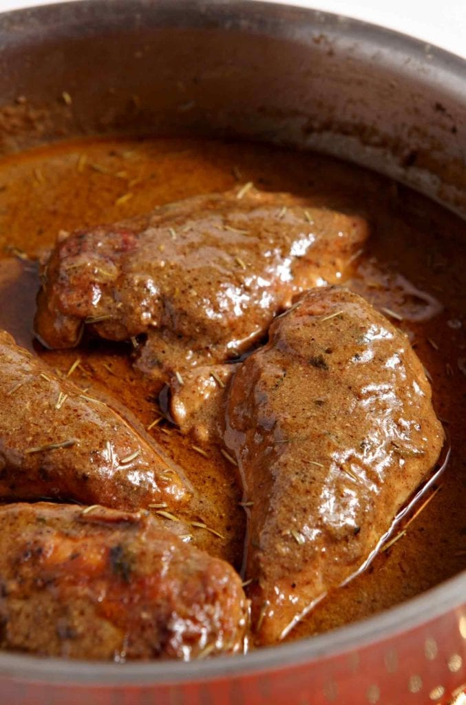 Mustard chicken in a saute pan before serving
