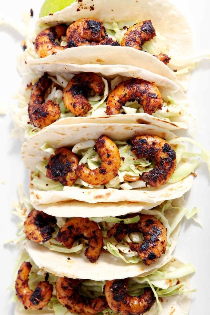 Close up of Blackened Shrimp Tacos from above on a white platter