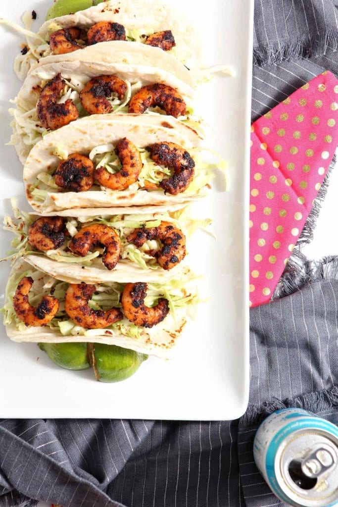 Blackened Shrimp Tacos are served on a white platter