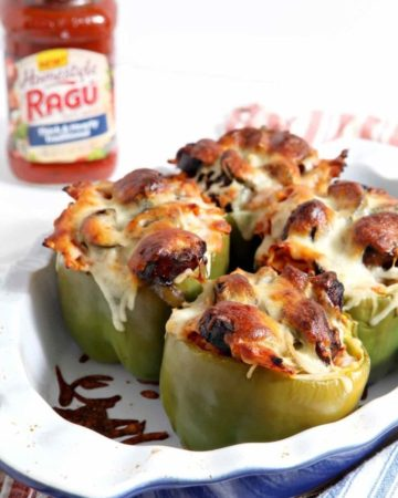Bowl of stuffed peppers and jar of sauce on side