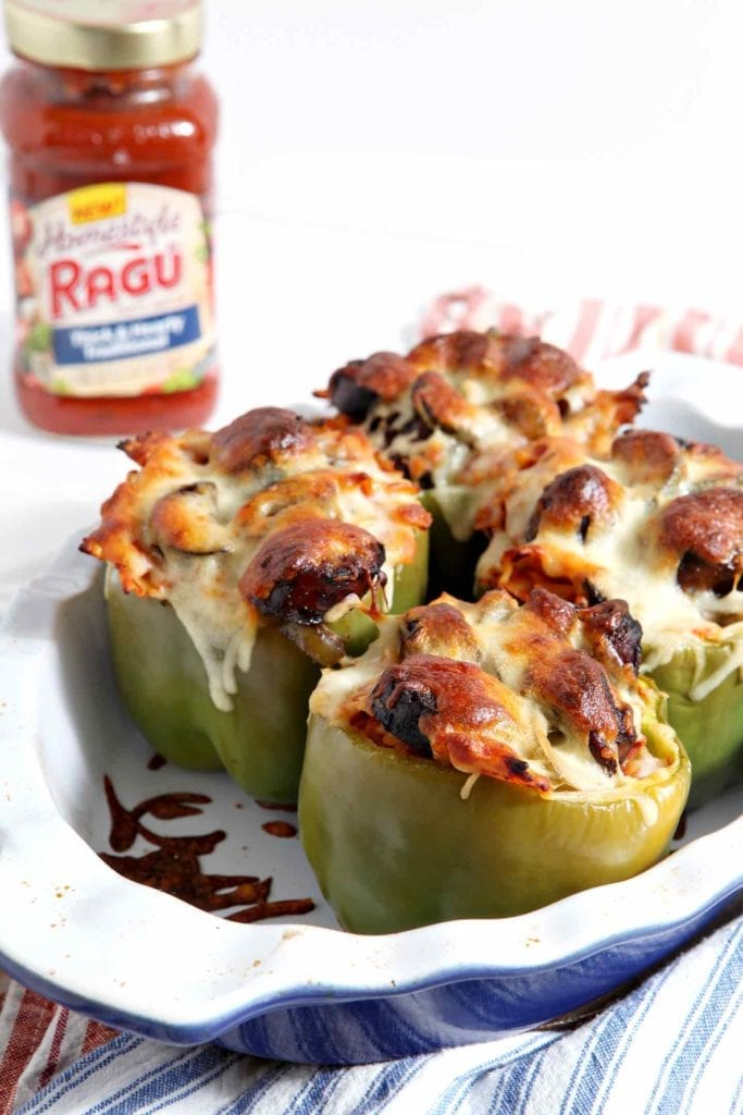 Italian Stuffed Peppers, made with RAGÚ® Homestyle Sauce, are a simple homestyle meal! As the pasta boils, prep the bell peppers and cook hot Italian sausages in a pan with a little bell pepper and fresh zucchini. When the pasta is ready, toss in RAGÚ® Homestyle Thick and Hearty Traditional Sauce, then layer it, the sausage and veggies into the bell peppers, top with mozzarella, and bake until golden brown. An easy, delicious weeknight dinner. #ad