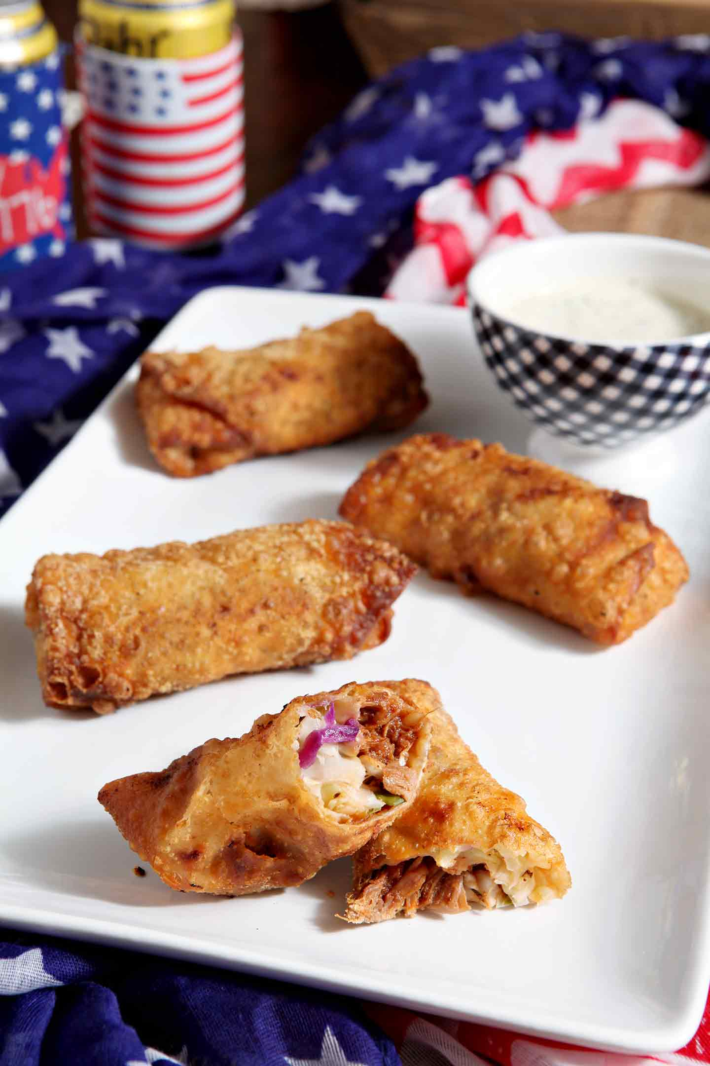 A Southern classic combined with an Asian favorite makes this delightful mash-up. Homemade Pulled Pork (in a tangy barbecue sauce!) is made in the slow cooker, then creamy coleslaw, made with yogurt instead of mayo, is tossed together. When ready, the pulled pork and coleslaw are rolled into eggroll wrappers, fried and served with creamy coleslaw sauce. Pulled Pork Coleslaw Eggrolls are a tasty appetizer to enjoy while watching the Summer Games! #spon