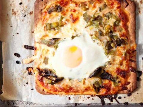 Overhead picture of cooked Hatch Chili Breakfast flatbread on baking sheet