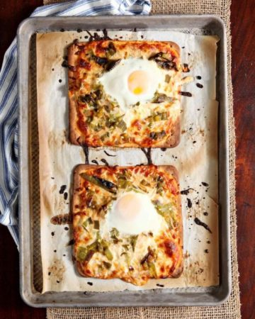 Overhead view of two Hatch Chile Breakfast Flatbreads on baking sheet