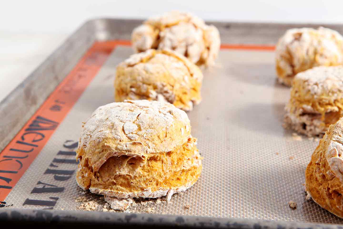 Close up of pumpkin biscuits on baking sheet