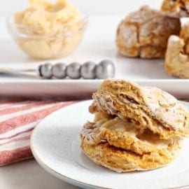 Celebrate the arrival of fall with these fluffy Pumpkin Biscuits with Honey Butter. Vegan biscuit dough is made with fresh or canned pumpkin puree, all-purpose flour, baking powder, unsweetened non-dairy milk, ground cinnamon and sea salt. Cut them into six large biscuits, then bake. Once they have risen, cooked through and cooled slightly, slice them in half and slather with homemade honey butter for the ultimate autumn-flavored decadence.