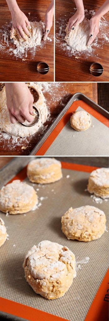 Hands cutting cutting out biscuit dough on baking sheet