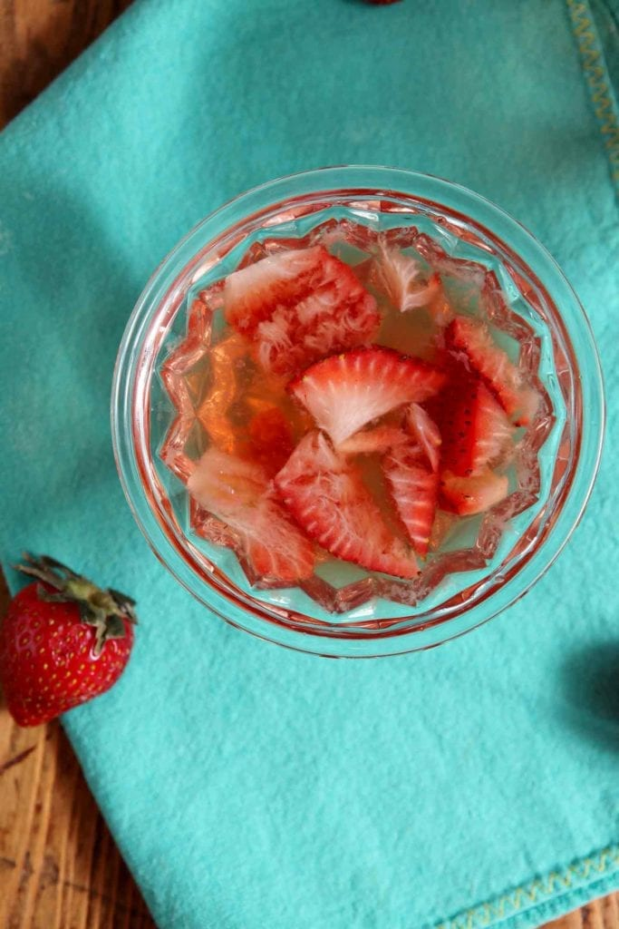 Celebrate fresh produce with these sweet, well balanced Strawberry Old Fashioned. Make strawberry simple syrup with water, granulated sugar and freshly sliced strawberries. When the mixture melds together and cools, use it to sweeten this twist on the classic Old Fashioned cocktail. A traditional Old Fashioned calls for your favorite whiskey (or bourbon), granulated sugar and bitters. The Strawberry Old Fashioned is a sweeter take on the classic!