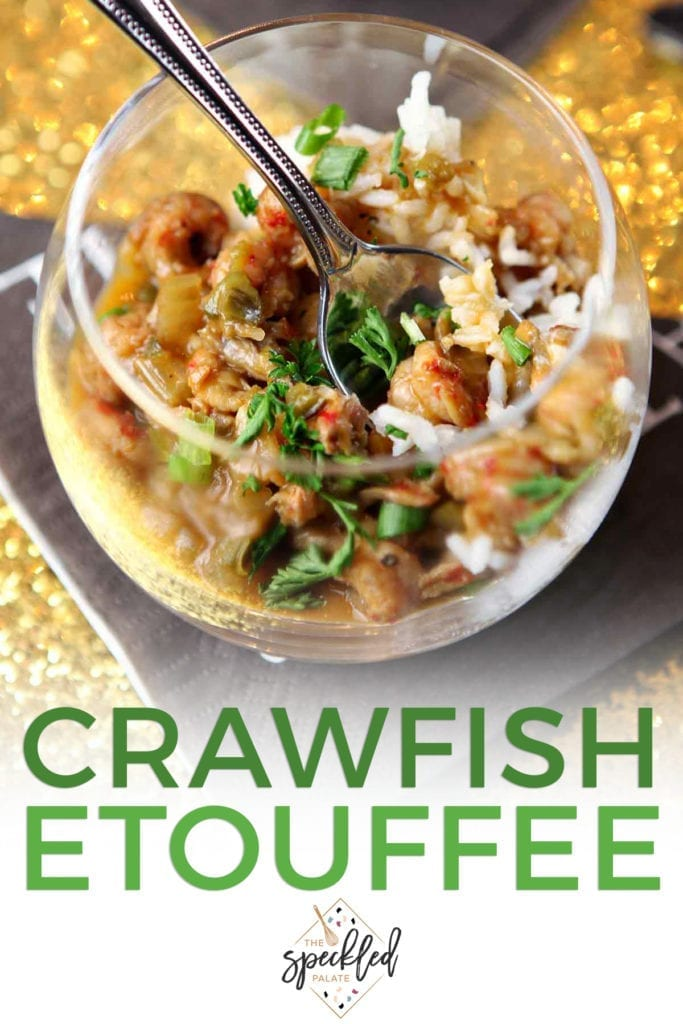 "Close up of a glass holding crawfish etouffee and a spoon with the text ""crawfish etouffee"""