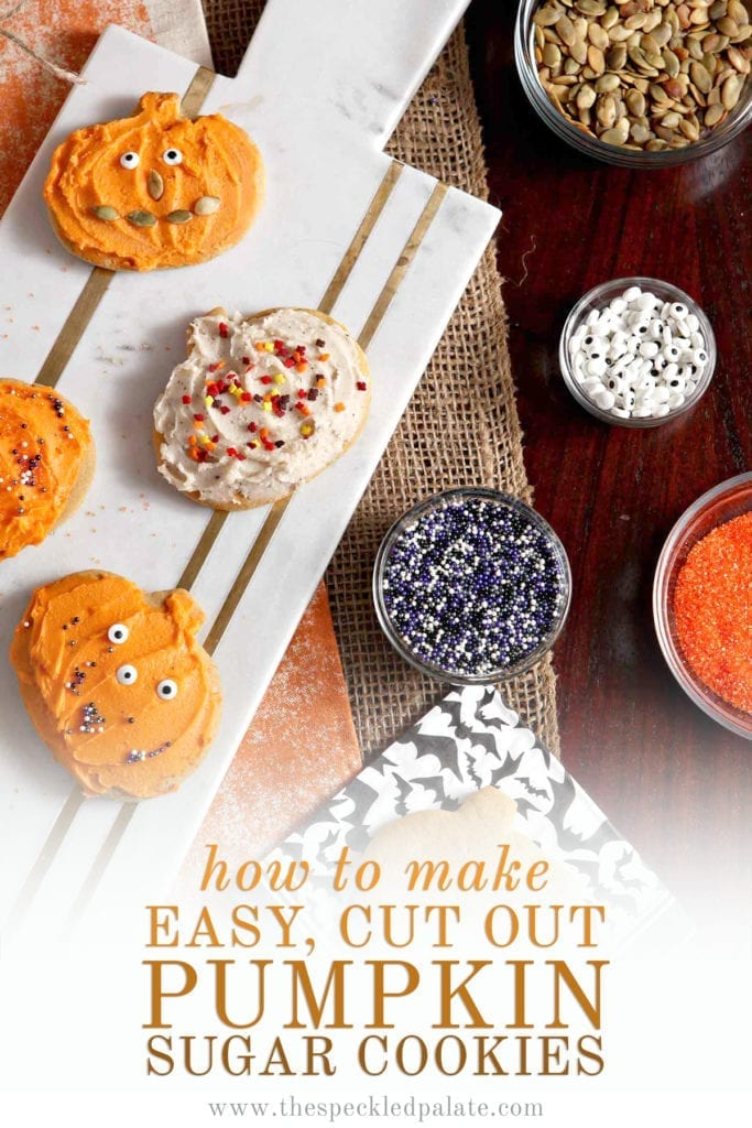 Decorated pumpkin cut out cookies sit on a marble slab next to bowls of sprinkles, eye candies, colored sugar and pumpkin seeds with the text 'how to make easy, cut out pumpkin sugar cookies'