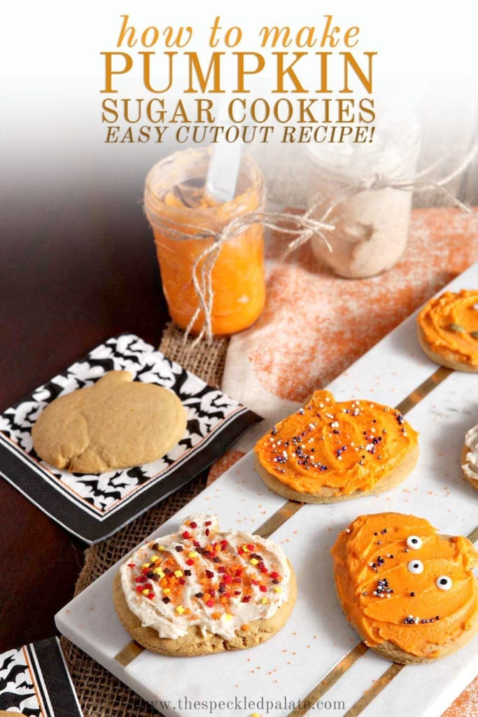 Decorated Pumpkin Sugar Cookies sit on a marble slab next to an undecorated cookie and jars of icing with the text 'how to make pumpkin sugar cookies easy cutout recipe!'