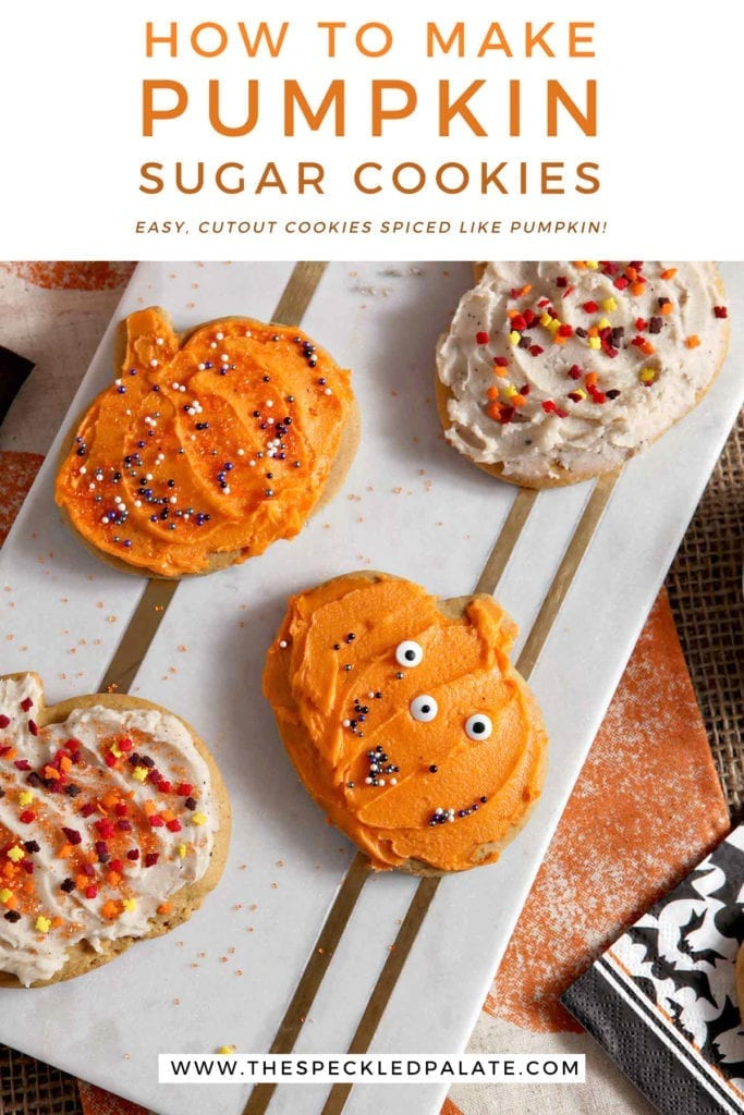 Decorated pumpkin cut out cookies sit on a marble slab with the text 'how to make pumpkin sugar cookies. easy cutout cookies spiced like pumpkins!'