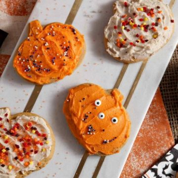 'Tis the season for pumpkin spiced everything! These flavorful Pumpkin Spice Sugar Cookies make the perfect seasonal sweet! This cookie dough, which features pumpkin puree, is soft baked and perfectly spiced. Seasoned with cinnamon, ground ginger and allspice, the delicious pumpkin flavor of these cookies sings. Treat guests to two options of frostings - brown butter and traditional - and these cookies are sure to fly off the table this fall.