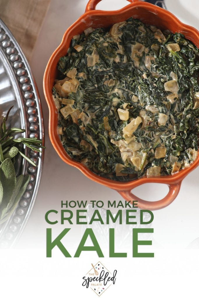 Close up of a pumpkin-shaped orange dish holding Creamed Kale on a holiday table with the text 'how to make creamed kale'