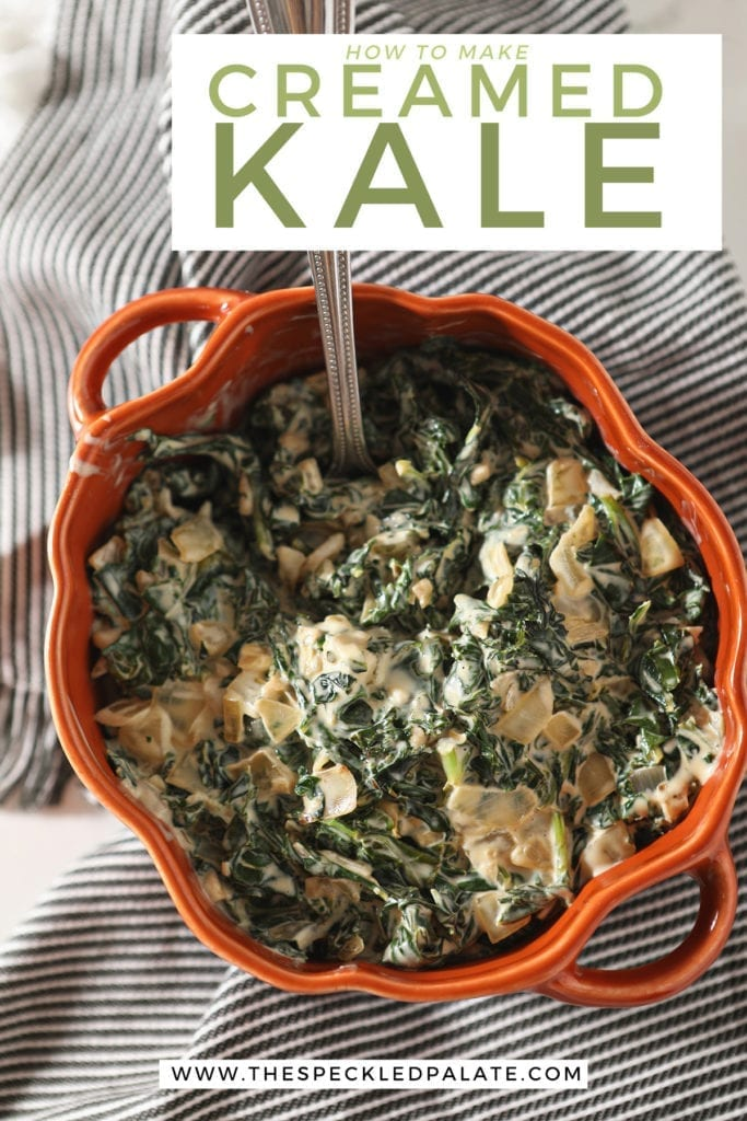 A silver spoon sits in an orange dish of Creamy Kale sitting on a gray striped towel with the text 'how to make creamed kale'