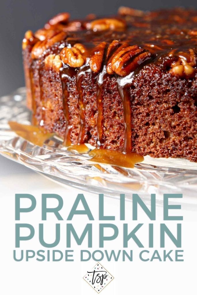 Close up of caramel drizzling down the side of a Praline Pumpkin Upside Down Cake with text for Pinterest