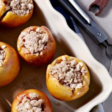 If you're in the market for a melt-in-your-mouth decadent side dish for the holiday table, you're in luck! Bacon Streusel Stuffed Baked Apples are a THING! Stuff apples with a sweet, spiced bacon fat streusel. Bake until the apples soften and the streusel browns, then serve warm alongside turkey or ham. These Bacon Streusel Stuffed Baked Apples are the ultimate sweet-savory-salty combination for Thanksgiving, Christmas or any winter dinner party!