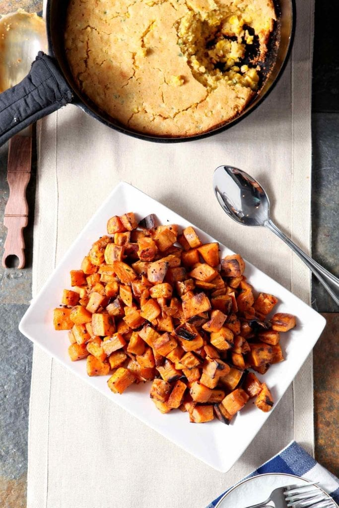 Overhead image of a white dish holding a pile of Bourbon Butter Sweet Potatoes