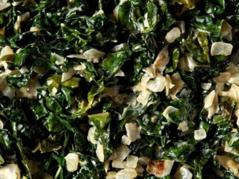 Close up of cooked creamy kale in a skillet from above