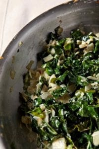 A twist on the classic, Creamed Kale is a creamy side dish to serve alongside turkey this season. This side comes together quickly and only requires a handful of ingredients. Warm olive oil in a skillet, then cook onion and garlic until translucent. Add kale, and sauté until wilted. Finally, add the cream, allowing the greens to soak it up, and serve the dish warm. Creamed Kale adds comforting deliciousness to any Thanksgiving or holiday feast.