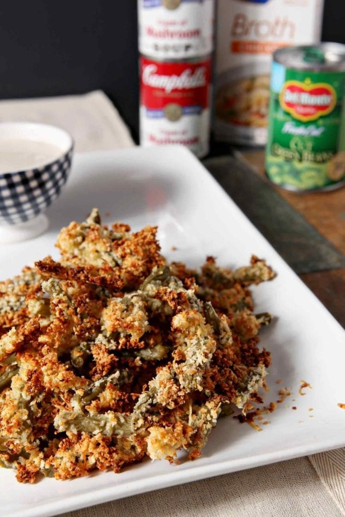 Want to make the ULTIMATE Friendsgiving appetizer? Crunchy Green Bean Casserole Bites with a Creamy Dipping Gravy is the recipe you're looking for! Transform traditional green bean casserole ingredients - Del Monte® <em>Blue Lake</em>® Cut Green Beans, <em>Campbell's</em>® Cream of Mushroom Soup and Swanson® Chicken broth - into a handheld appetizer and dipping gravy that are sure to wow. Ready in less than 50 minutes, these easy bites are scrumptious! #ad #GiveThanksBeFull